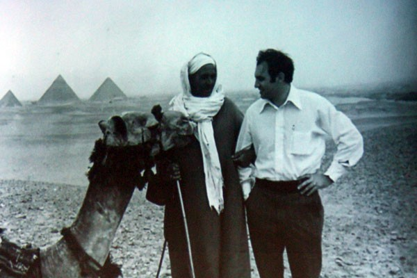Kirk Wayne in Desert with client and a camel.
